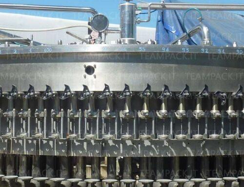 Monoblocco composto da riempitrice isobarica 100 valvole tappatore Arol 20 teste tappanti